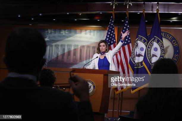 Speaker of the House Nancy Pelosi talks to reporters during her weekly news conference in the House Visitors Center at the U.S. Capitol on October...