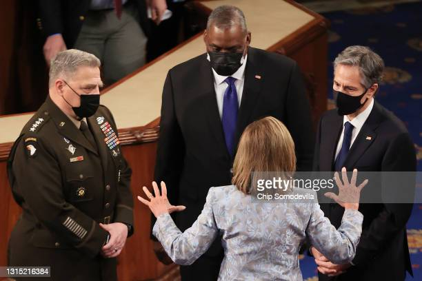 Speaker of the House Nancy Pelosi talks with Chairman of the Joint Chiefs of Staff Gen. Mark Milley, Defense Secretary Lloyd Austin and Secretary of...