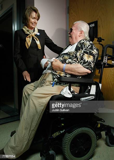 S Speaker of the House Nancy Pelosi talks with military veteran Donnie Ruth at the VA hospital nursing home November 12 2007 in San Francisco...