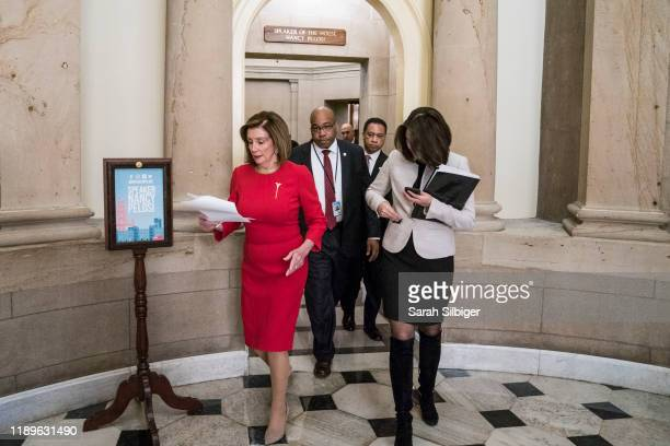 Speaker of the House Nancy Pelosi walks from her office in the US Capitol to the House floor where members debate the United StatesMexicoCanada...