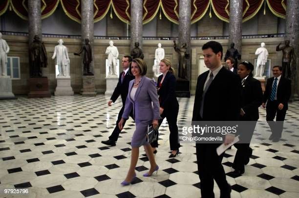 Speaker of the House Nancy Pelosi walks through Statuary Hall on her way to the House Chamber ahead of a historic vote on health care reform at the...