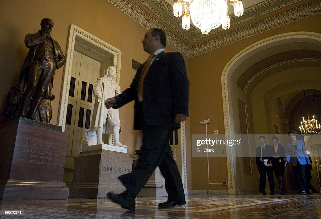 Speaker of the House Nancy Pelosi walks through the Ohio Clock Corridor on her way to have lunch with Senate Democrats on Thursday, Jan. 18, 2007.