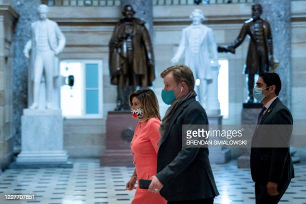 Speaker of the House Nancy Pelosi walks to the House floor on Capitol Hill before a moment of silence for civil rights activist Rep John Lewis who...