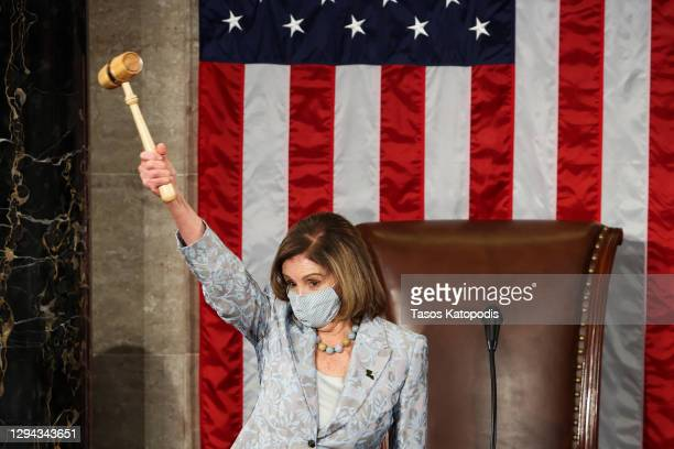 Speaker of the House Nancy Pelosi waves a gavel during the first session of the 117th Congress in the House Chamber at the US Capitol on January 03,...