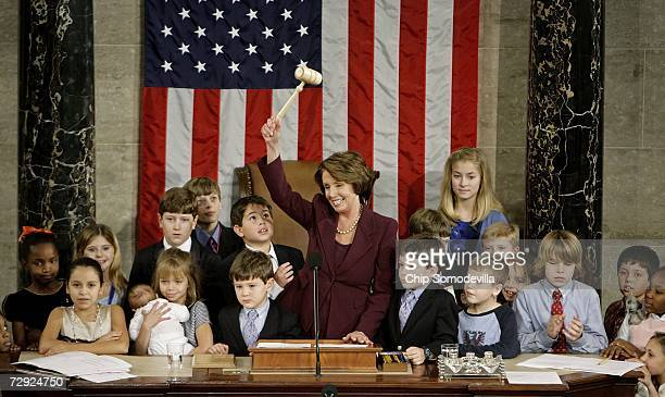 Speaker of the House Nancy Pelosi waves the Speaker's gavel while surrounded by her own grandchildren and the children of other members of Congress...