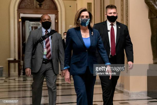 Speaker of the House Nancy Pelosi wears a protective mask while walking to her office from the House Floor at the U.S. Capitol on January 12, 2021 in...