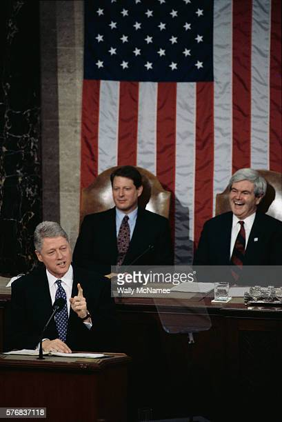 Speaker of the House Newt Gingrich sits with Vice President Al Gore laughing during President Clinton's State of the Union address to Congress