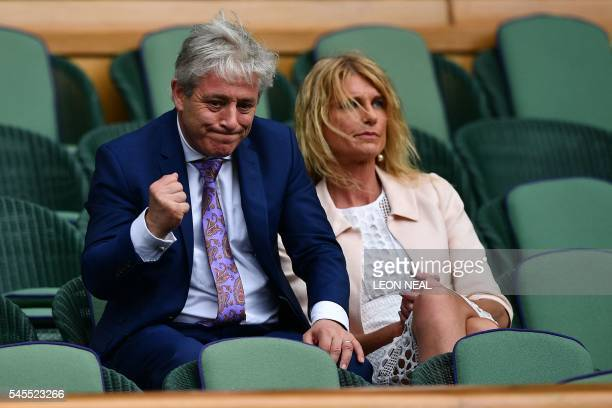 Speaker of the House of Commons John Bercow gestures next to his wife Sally in the royal box before the start of the men's singles semifinal match...