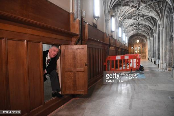 Speaker of the House of Commons Lindsay Hoyle poses leaving a secret chamber concealing a 360-year-old blocked passageway rediscovered during...