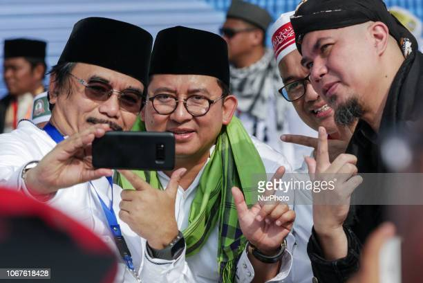Speaker of the House of Representatives of the Republic of Indonesia Fadli Zon and the musician Ahmad Dhani gesturing a election campaign number for...
