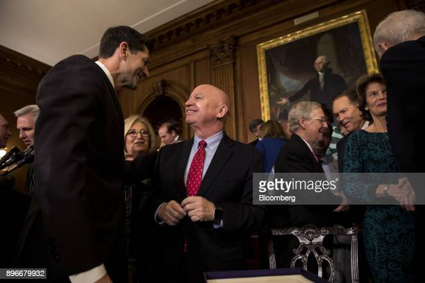 Speaker of the House Paul Ryan a Republican from Wisconsin left speaks with Representative Kevin Brady a Republican from Texas during a Tax Cuts and...