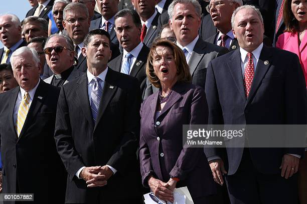 Speaker of the House Paul Ryan and House Minority Leader Nancy Pelosi join members of the House of Representatives in singing 'God Bless America' on...