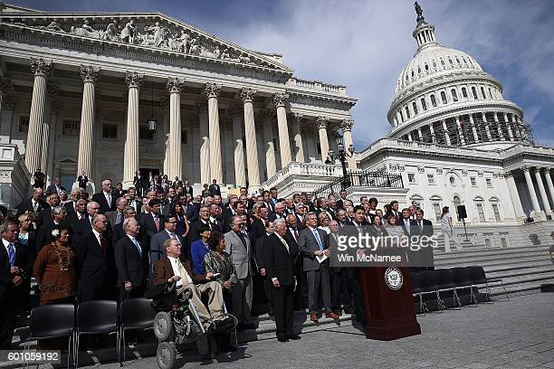 Speaker of the House Paul Ryan and House Minority Leader Nancy Pelosi join members of the House of Representatives on the steps of the US Capitol for...