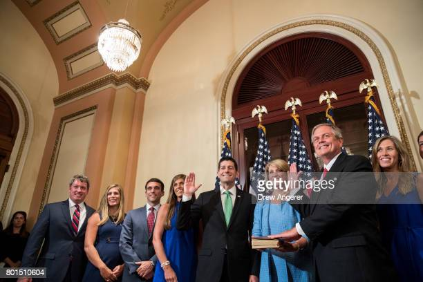 Speaker of the House Paul Ryan and Representativeelect Ralph Norman surrounded by family participate in a ceremonial swearingin on Capitol Hill June...