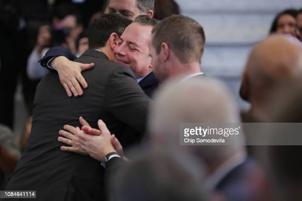 Speaker of the House Paul Ryan embraces former Trump White House Chief of Staff Reince Priebus after delivering a farewell address in the Great Hall...