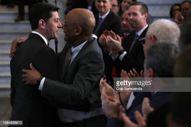 Speaker of the House Paul Ryan embraces Robert Woodson after delivering a farewell address in the Great Hall of the Library of Congress Jefferson...