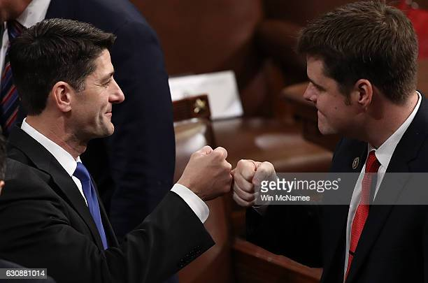 Speaker of the House Paul Ryan gets a fist bump from fellow member of the House of Representatives Matt Gaetz after Ryan was reelected January 3 2017...