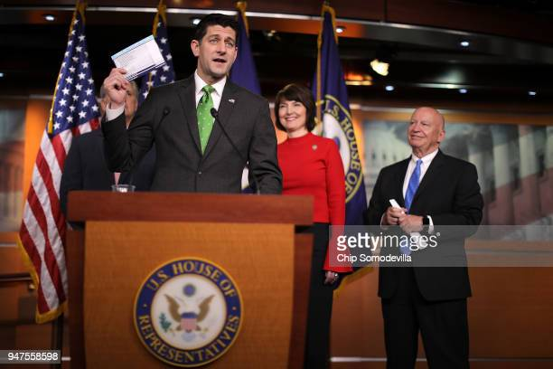 Speaker of the House Paul Ryan holds up an example of a proposed tax form during a news conference with Rep Cathy McMorris Rodgers and House Ways and...