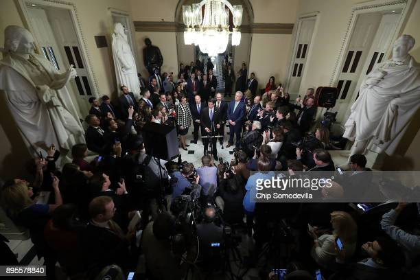 Speaker of the House Paul Ryan is joined by House Republican leaders while talking to reporters following passage of the Tax Cuts and Jobs Act in the...