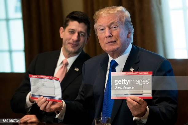 Speaker of the House Paul Ryan looks on as President Donald Trump speaks about tax reform legislation in the Cabinet Room at the White House November...