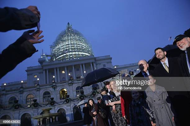 Speaker of the House Paul Ryan poses for photographs with members of the Alaska delegation during the Capitol Christmas tree lighting ceremony on the...