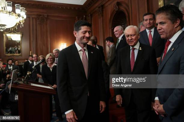 Speaker of the House Paul Ryan Senate Finance Committee chairman Sen Orrin Hatch Sen Ted Cruz and Rep Mike Bishop leave following a press event to...