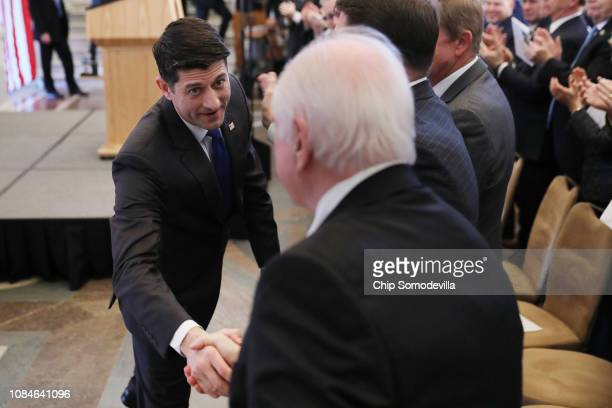 Speaker of the House Paul Ryan shakes hands with members of Congress after delivering a farewell address in the Great Hall of the Library of Congress...