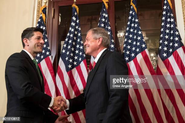 Speaker of the House Paul Ryan shakes hands with Representativeelect Ralph Norman during in a ceremonial swearingin on Capitol Hill June 26 2017 in...