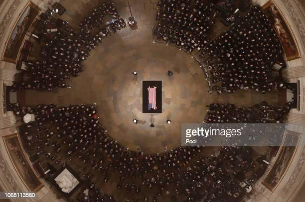 Speaker of the House Paul Ryan speaks as Former President George H. W. Bush lies in state in the U.S. Capitol Rotunda on December 03, 2018 in...
