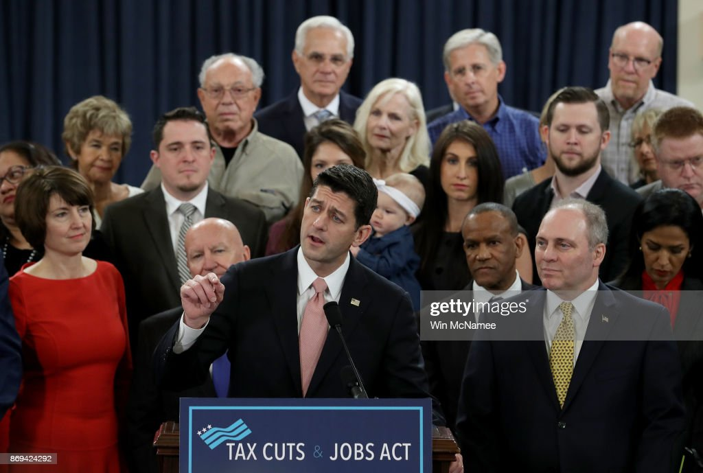 Speaker of the House Paul Ryan (R-WI), surrounded by American families, and members of the House Republican leadership introduce tax reform legislation November 2, 2017 in Washington, DC. The tax reform legislation is a centerpiece of U.S. President Donald Trump's legislative agenda.