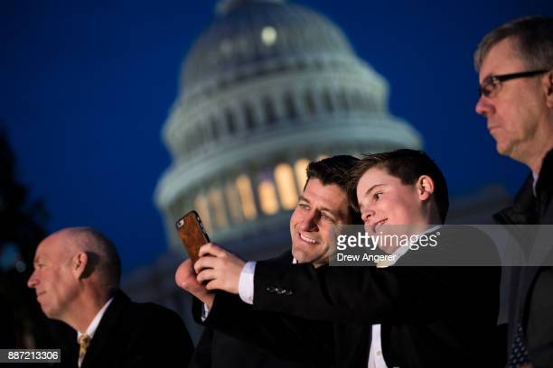 Speaker of the House Paul Ryan takes a 'selfie' photograph with Ridley Brandmayr, the 11-year-old from Bozeman, Montana who was chosen to light the...