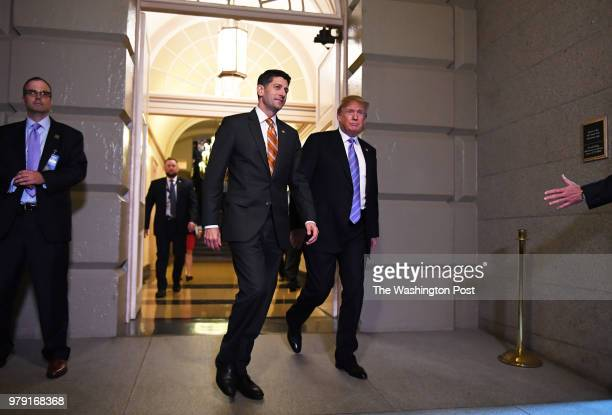 Speaker of the House Paul Ryan walks with President Donald Trump before a meeting with House Republicans at the United States Capitol Hill on Tuesday...