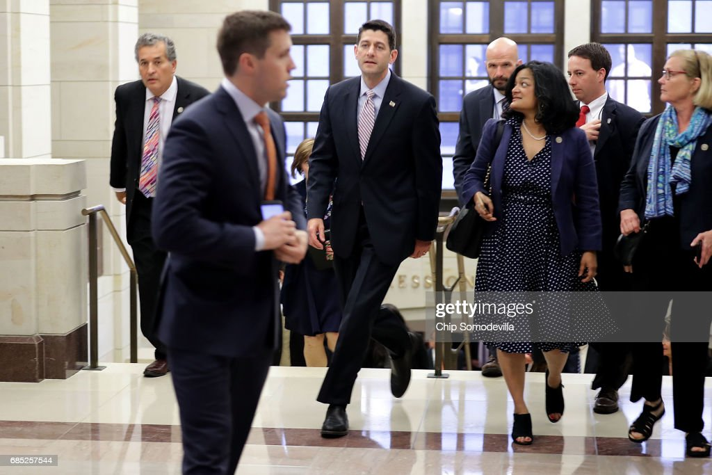Speaker of the House Paul Ryan (R-WI) (3rd L) zips past fellow members of the House of Representatives following a closed-door briefing with Deputy U.S. Attorney General Rod Rosenstein at the U.S. Capitol May 19, 2017 in Washington, DC. Rosenstein met with senators a day earlier and was questioned about his role in the firing of former FBI Director James Comey and his appointment of former FBI Director Robert Mueller as a special counsel to investigate Russian meddling in the 2106 presidential election.