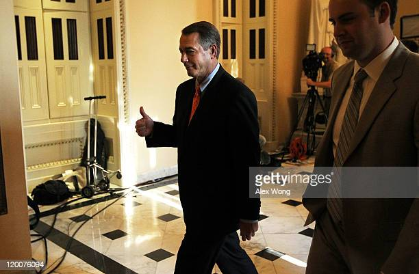 S Speaker of the House Rep John Boehner gives a thumbs up as he passes by members of the media after a vote on the Budget Control Act July 29 2011 at...