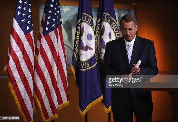 S Speaker of the House Rep John Boehner leaves after a press briefing July 31 2014 on Capitol Hill in Washington DC Boehner held his weekly news...