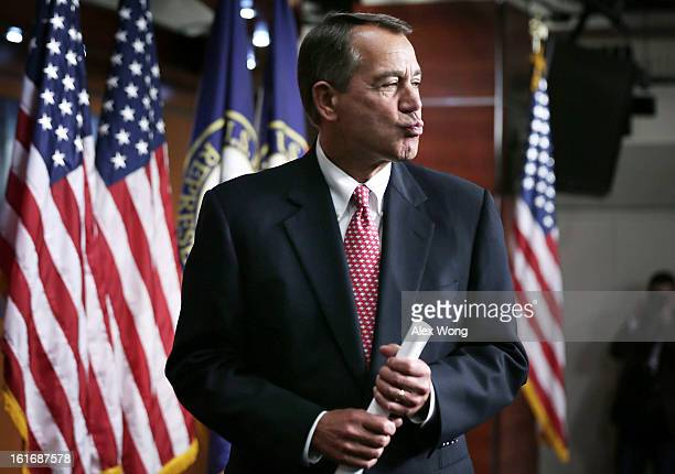 S Speaker of the House Rep John Boehner puckers up when he is asked by a reporter what he had given to his wife for Valentine's Day at the end of a...