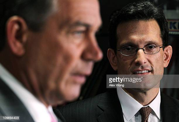 S Speaker of the House Rep John Boehner speaks as House Majority Leader Rep Eric Cantor looks on during a media briefing at the Republican National...