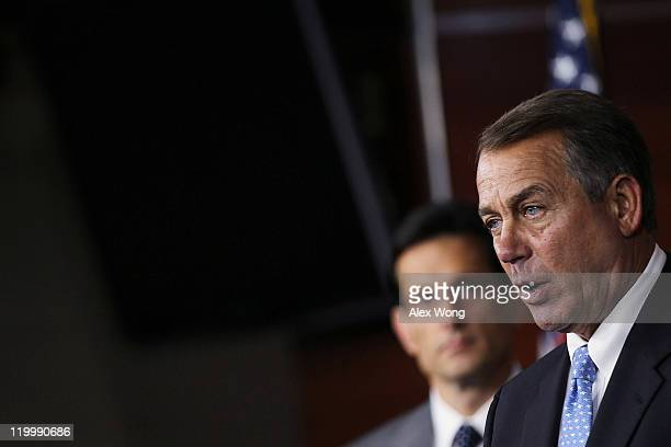 S Speaker of the House Rep John Boehner speaks as House Majority Leader Rep Eric Cantor listens during a news conference July 28 2011 on Capitol...