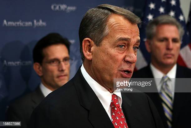 S Speaker of the House Rep John Boehner speaks as House Majority Leader Rep Eric Cantor and House Majority Whip Rep Kevin McCarthy listens during a...