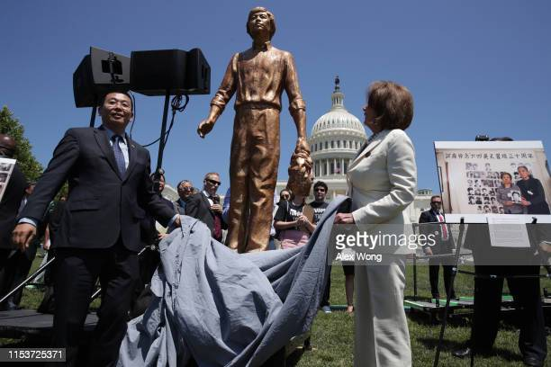 S Speaker of the House Rep Nancy Pelosi and Chinese dissident Yang Jianli unveil the Tank Man statue during a rally to commemorate the 30th...