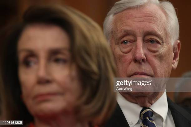 S Speaker of the House Rep Nancy Pelosi and House Majority Leader Rep Steny Hoyer listen during a news conference at the US Capitol January 30 2019...