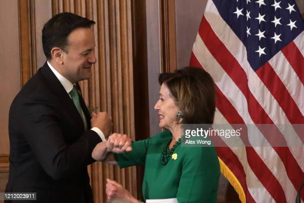 Speaker of the House Rep. Nancy Pelosi and Irish Taoiseach Leo Varadkar elbow-bump each other during the annual Friends of Ireland luncheon at the...