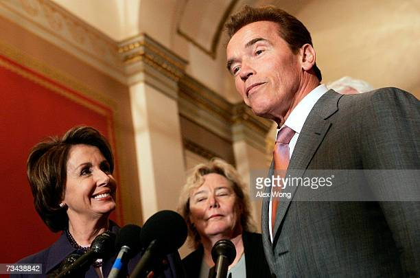 US Speaker of the House Rep Nancy Pelosi and US Rep Zoe Lofgren listen as California Gov Arnold Schwarzenegger speaks during a briefing after their...