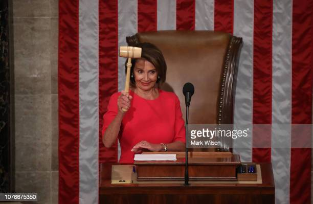 Speaker of the House Rep Nancy Pelosi holds the gavel during the first session of the 116th Congress at the US Capitol January 3 2019 in Washington...