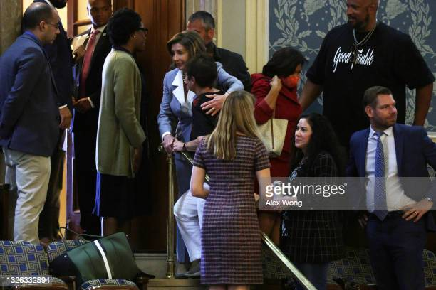 Speaker of the House Rep. Nancy Pelosi hugs Gladys Sicknick , mother of fallen U.S. Capitol Police Officer Brian Sicknick, after a vote on creating a...
