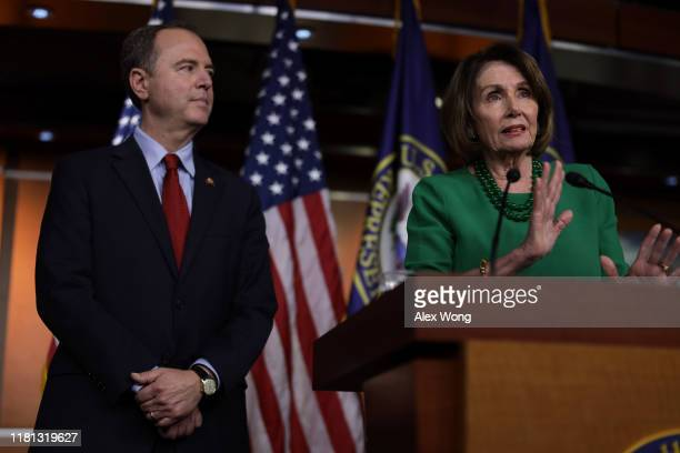 S Speaker of the House Rep Nancy Pelosi speaks as Chairman of House Intelligence Committee Rep Adam Schiff listens during a news conference at the US...