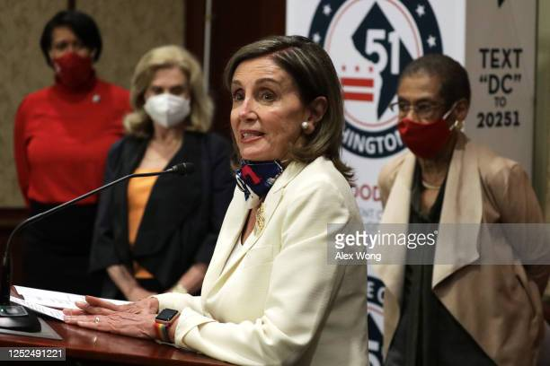S Speaker of the House Rep Nancy Pelosi speaks as DC Mayor Muriel Bowser Rep Carolyn Maloney and Rep Eleanor Holmes Norton listen during a news...
