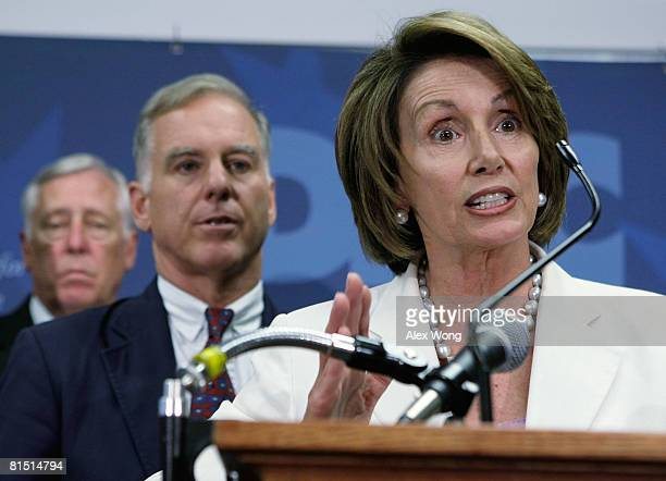 S Speaker of the House Rep Nancy Pelosi speaks as Democratic National Committee Chairman Howard Dean and House Majority Leader Rep Steny Hoyer listen...