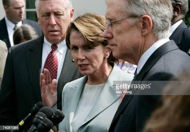 S Speaker of the House Rep Nancy Pelosi speaks as House Majority Leader Rep Steny Hoyer and Senate Majority Leader Sen Harry Reid listen during a...