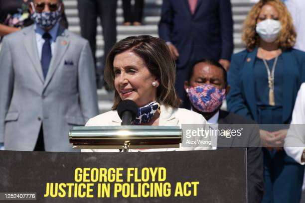 Speaker of the House Rep. Nancy Pelosi speaks as other House Democrats listen during an event on police reform June 25, 2020 at the east front of the...